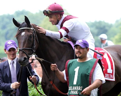 Mike Smith shares a moment with Royal Delta in the paddock prior to winning the 75th Running of The Delaware Handicap at Delaware Park on July 21, 2012.
