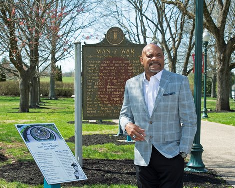 in front of plaques for the Man o' War statue by the Isaac Murphy Memorial Garden Ron Mack with Legacy Equine Academy at the Kentucky Horse Park in Lexington, Ky., on March 30, 2021.