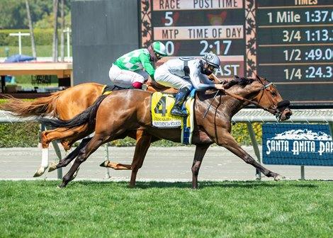 Going Global and jockey Flavien Prat, outside, hold off Closing Remarks (Umberto Rispoli) to win the Grade III $100,000 Providencia Stakes Saturday, April 3, 2021 at Santa Anita Park, Arcadia, CA