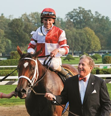 Owner Rick Porter leads Havre de Grace ridden by Ramon Dominguez to the winner's circle after winning the 58th running of The Woodward at the Saratoga Race Course in Saratoga Springs, N.Y. Sept 3, 2011.  (Skip Dickstein / Times Union)
